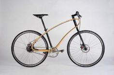 De houten, flexibele fiets van JAN