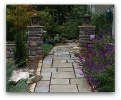 A formal front walkway with some creativity. Notice on the left the way the formal cut stones were built around what appears to be a small outcropping of rocks.