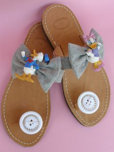 Handmade leather sandals with cartoons, big knots, buttons covered with swarovski flat back and French ribbons