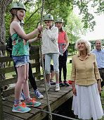 Camilla Duchess of Cornwall meets young children as she visits the Poppy Pod Village at the Tile Barn Outdoor Centre on July 26 2016 in Brokenhurst...
