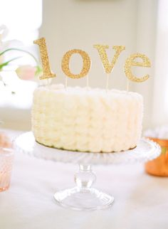 Glittering gold cake topper: http://www.stylemepretty.com/2015/07/03/sparkling-fourth-of-july-details-we-love/