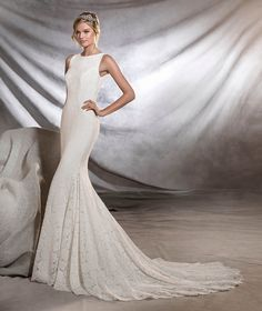ORNANI - Lace wedding dress, bateau neckline, fitted to the hips