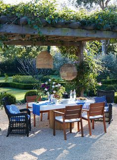 Enchanted afternoon garden party under an ivy-covered pergola.