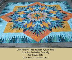 Hawaiian Star ~ Quiltworx.com, made by Patti Docs and quilted by Lara Nale