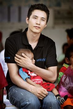 WonBin. Who doesn't love a man who loves kids and isn't afraid to hold them?