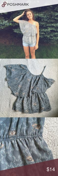 One Shoulder Blouse Beautiful one shoulder, flowy blouse by Studio Y from Maurices. Grayish color with green and pink hints in the pattern. Spaghetti strap is adjustable. Elastic waist creates a peplum style. Top is lined however shell is chiffon/see-through Maurices Tops Blouses