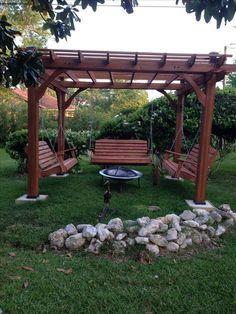 Great outdoor area with pergola, swings and fire pit. #pergolafirepitideas #trellisfirepit #pergolakits