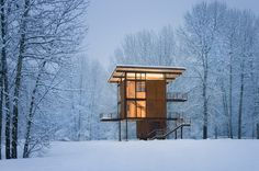 This 1,000 square-foot weekend cabin, basically a steel box on stilts, can be completely shuttered when the owner is away. Situated near a river in a floodplain, the 20' x 20' square footprint rises three stories and is topped by the living room/kitchen. Large, 10' x 18' steel shutters can be closed simultaneously using a hand crank.