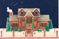 Former Second-Place Winner This festive home by Joan Grunzweig of Los Alamitos, CA, is sweet and solid. The roof is black chewing gum; for landscaping, Grunzweig piped green royal icing over ice-cream cones and marshmallows.