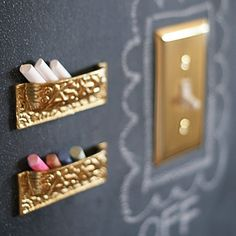 Keep chalk in upside-down drawer pullson a panel of chalkboard wall. That way it's within reach for kids to use for doodling.