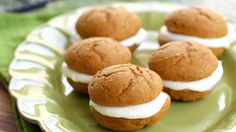 Pumpkin whoopie pies with cream cheese filling inside. These have the perfect amount of spice and are made easy from a cake mix.