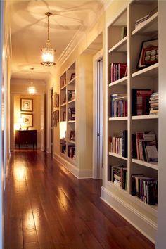 YES bookshelves lining the hallway