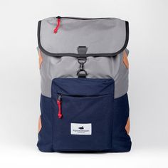 Some things never go out of style. Classic pull string backpack featuring a pocketed flap top and exterior zipper pocket for stowing small accessories. Its roomy