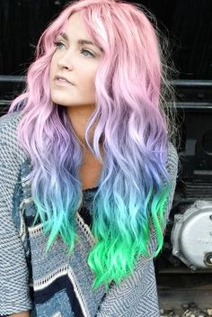 Beautiful pastel rainbow hair! Love the transition from pink to purple to blue to teal to green... not to mention those textured waves as well! Want to protect your hair color? Why not try Julien Farel's Vitamin Restore treatment?! #haircolor #hairgoals #rainbow #rainbowhair #getthelook #trendsetter #lifestyle #bloggerstyle #streetstyle #waves #texture #colors #vivid #hairdye #dye #modernsalon #goals #tipsandtricks #salonsandspa #haircare #hairtreatments #love #stylis