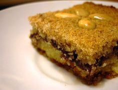 Basbousa bil Tamr | Arabic Semolina Cake with Date filling, #middleeasternfood #recipe #dessert