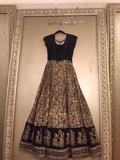 Black and gold anarkali with Krishna and gopi.