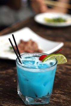 Happy Colada (2 oz coconut rum 1 1/2 oz Blue Curacao liqueur 6 oz pineapple juice)