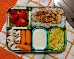 Teriyaki chicken with rice, grilled corn off the cob, veggies and ranch dressing, strawberries and raspberries, and havarti cheese. #bentobox #lunchbots #lunchtime #bento #leftovers #lunch