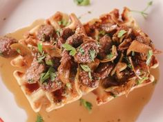 Get Bobby Flay's Cheddar-Black Pepper Waffles with Sausage and Apples Maple Agrodolce Recipe from Food Network
