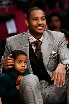 Carmelo Anthony of the Denver Nuggets sits with his son Kiyan Carmelo Anthony during the T-Mobile Rookie Challenge and Youth Jam at Staples Center on Feb. 18, 2011