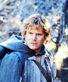 Okay, so the best model I could come up with for Sam is ... ::drumroll:: a young Sean Astin, possibly as Samwise from The Lord of the Rings. :-) The same earnest, solid look. If you can picture him with blond hair pulled back and queued, and with blue eyes. Oh, and proper colonial working-man's dress. :-)