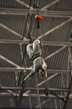 A rappelling instructor from the Air Assault School at Fort Campbell, Ky., practiced rappelling from the ceiling of San Antonio's Alamodome to the playing field, 180 feet below, Jan. 2.
