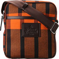 Vivienne Westwood Man Tartan Small Bag. If the color isn't bold enough for you, check out the lining. This bag screams delicious.