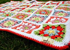 Gorgeous blanket made by Nook, based on the pattern of the summer garden granny square by lucy of Attic24 here http://attic24.typepad.com/weblog/summer-garden-granny-square.html