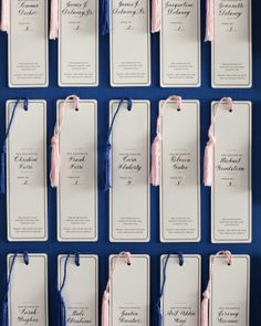 Bookmark Escort Cards. In keeping with the literary theme of this couple's reception location, letterpressed bookmarks, calligraphed with attendees' names, led them to their seats.
