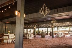 Cocktail hour in a barn with chandeliers - no better way to do it! #cedarwoodweddings Rustic Luxe Destination Wedding at Historic Cedarwood | Cedarwood Weddings