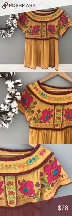 "NWOT Ivy Jane Embroidered Floral Blouse Size XS NEW without tags -- gorgeous, quirky, and fun -- beautiful mustard top with every detail accounted for. Beautiful button detail lines the side, intricate embroidery all over the top, fringe and Pom detailing. Very soft, flowy rayon fabric will keep you cool all summer long. 26"" length 33.5"" bust. Size XS but flowy. ivy jane Tops Blouses"