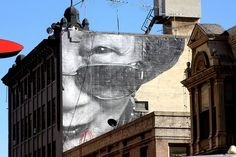 The Best Los Angeles Street Art of 2012: LAist. JR downtown (Photo by Lord Jim)