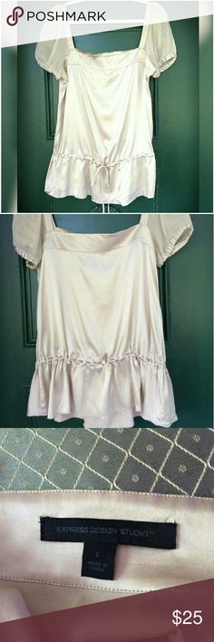 Express Silk Top This like new drawstring bottom top is silk and spandex blend. It is stretchy so it will form to you. I noted a tiny snag on the back of the right sleeve in the last image. It is barely visible. No pets, no smoking, no trades. Express Tops Blouses