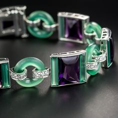 Suffragette jewelry nonpareil! A combination of wearable art and feminist statement, and a striking color combination are all wrapped up in this dramatically stunning and collectable rarity by the eminent American jeweler - Black Starr and Frost. Strikingly designed and hand fabricated in platinum, circa 1920, the fabulous bracelet is composed of green chalcedony, royal purple glass, and small round diamonds.
