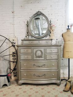 Painted Cottage Chic Shabby Silver Slipper Dresser with Mirror. $1,495.00, via Etsy.