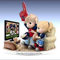 Cheer on your favorite football team, the Oakland Raiders, with this exciting Precious Moments fan figurine! Featuring an adorable couple watching a game on TV and rooting for their beloved Raiders, this spirited collectible figurine is truly a must-have: Go Broncos, Broncos Fans, Patriots Fans, Denver Broncos, Chiefs Football, Football Fever, Vikings Football, Raiders Football, Football Baby