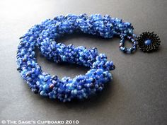 Flutterby Double Spiral Necklace by The Sage's Cupboard - very clear tute on round double spiral. #seed #bead #tutorial