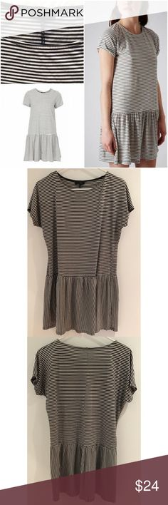 "Topshop DARK GRAY Dropped Waist Stripe Tunic Dress Gently used and still in great condition is this dark gray and black stripe babydoll drop waist dress from Topshop in size 4. More oversized style so might fit a 6 too. No major flaws. Light weight. Measure about 30"" length, 21"" pit to pit, 9"" sleeves, waist and hips are free. ❌Model pics is the same style but lighter. My dress is darker gray❌No trades or modeling. Open to reasonable offers. 15% OFF BUNDLING DEAL. Thank you‼ Topshop Dresses…"