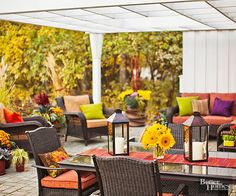 """Add color and pattern to your patio with fabrics. """"There's nothing like new pillows and cushions to change the whole mood of a place,"""" says garden designer Jon Carloftis. """"Outdoor fabrics no longer have to be plasticky and uncomfortable to withstand the weather."""" Toss in some patterned pillows with solids for a more dynamic look and include ottomans and floor pillows for extra seating."""