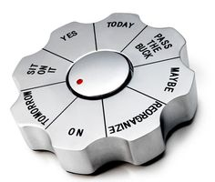 "Decision Paperweight ($15): Can't make that decision? Not to worry, this useful paperweight will do it for you — just spin it for an answer. Options include, ""sit on it,"" ""tomorrow,"" and ""maybe,"" with a few more decisive answers thrown in for good measure."