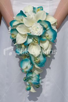 Very pretty and delicate, although I know orchids are expensive.  Not sure how this would look if the dress had a lace overlay. It's also a silk bouquet, so do real orchids even come in this color? - turquoise wedding Flowers | Stunning Artificial Turquoise Orchid & Ivory Calla Lily Cascading ...