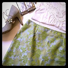 """XOXO   Green Floral Skirt Talk about flower power! Shape-adding darts only add an extra feminine touch to this brocade feel patterned skirt, which features shimmery green and yellow flowers against a icy bluish/gray/silver background. Rear zipper closure. Length: 17"""". Waist: 15.5"""" laid flat (or about 31"""" all around). 100% polyester; dry clean only. Like-new condition! By XOXO, sold at Macy's. Make me an offer I can't resist! 😃✌🏾️ XOXO Skirts"""
