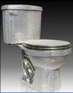 OMG!!!  Ahahaha!! I love LOVE this!!! Why did this picture just make my day!!! Bling Toilet!!