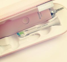 Pink phillips sonicare toothbrush