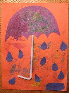 I haven't met a toddler yet that doesn't enjoy glue and glitter. Cut the pieces of rain, puddle and umbrella and let your child glue their hearts happy. We used a flexible straw and glued it to the construction paper for the base of the umbrella. What started out to be a glitter umbrella turned into a glitter rain party.  This looks alot more fun than I had in mind and my son had tons of fun!