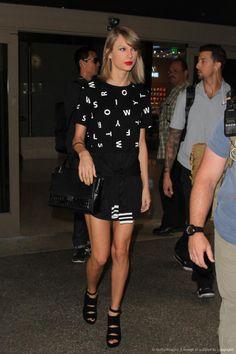 Taylor Swift wearing Elizabeth and James Charlie Satchel, Stuart Weitzman Black Suede Slits Platform Sandals and Heritage 66 Taylor Swift Dress