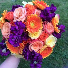 Plum purple and orange wedding flowers for a fall wedding with daisies and roses.