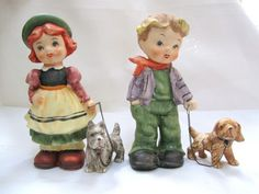 2 VINTAGE JAPAN BOY & GIRL PORCELAIN FIGURINES w/ PUPPY DOGS on CHAIN SONSCO 7""