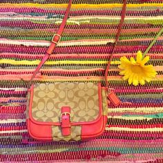 Coach Hadley Signature Field Bag Authentic tan and brown Coach purse with red orange trim! Beautiful and perfect for spring and summer! Has metal snap closure and a clean dark brown interior. Interior has one zipper pocket and a open front compartment (shown in top half of the fourth picture). Back also has an open pocket (shown in bottom half of the fourth picture). Strap is long enough to be crossbody or shoulder! Coach Bags Crossbody Bags