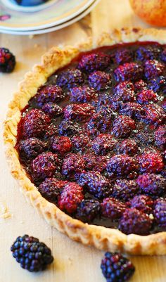 Blackberry tart (with lemon zest). Great Summer dessert made with fresh berries! Serve warm with a scoop of vanilla ice-cream!